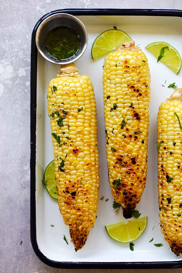 Easy delicious honey butter grilled corn, in a baking tray.