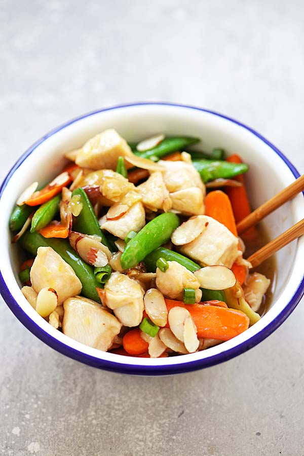 Easy and quick Asian Almond Chicken stir-fry with almonds, peas and carrots in Chinese brown sauce.