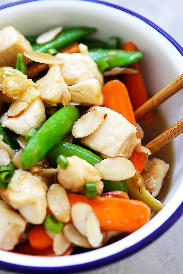 Almond Chicken - tender and juicy chicken stir-fry with almonds, peas and carrots in Chinese brown sauce. So good and much better than takeout | rasamalaysia.com