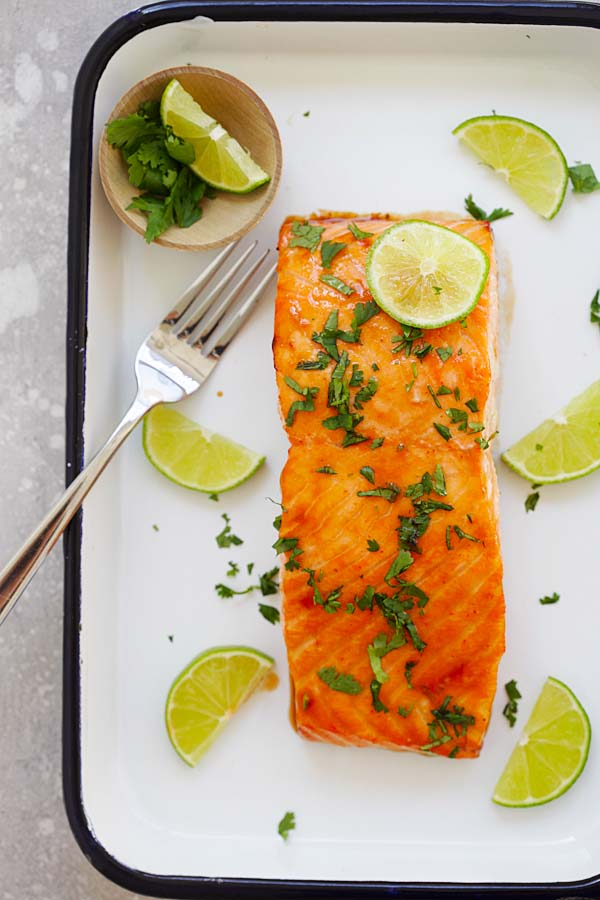 Easiest and best oven-baked cilantro lime salmon with a fork.