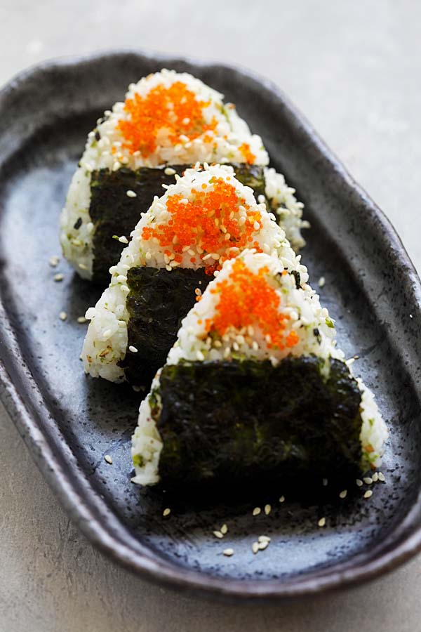 Easy and quick Japanese rice balls snacks shaped in triangles and wrapped with seaweeds.