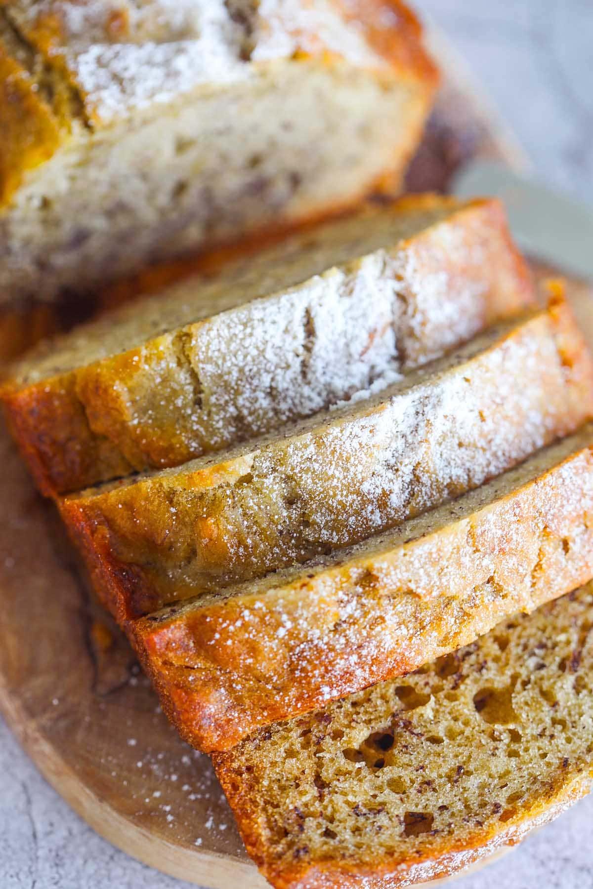 Moist banana bread on a serving platter.