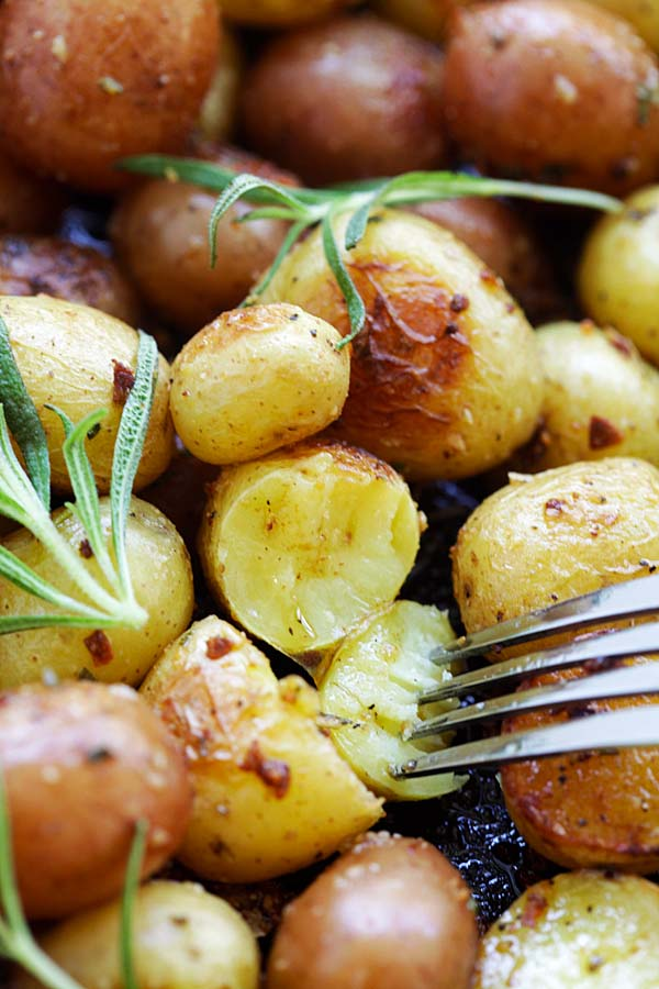Rosemary Roasted Potatoes cut in half and poked with a fork.