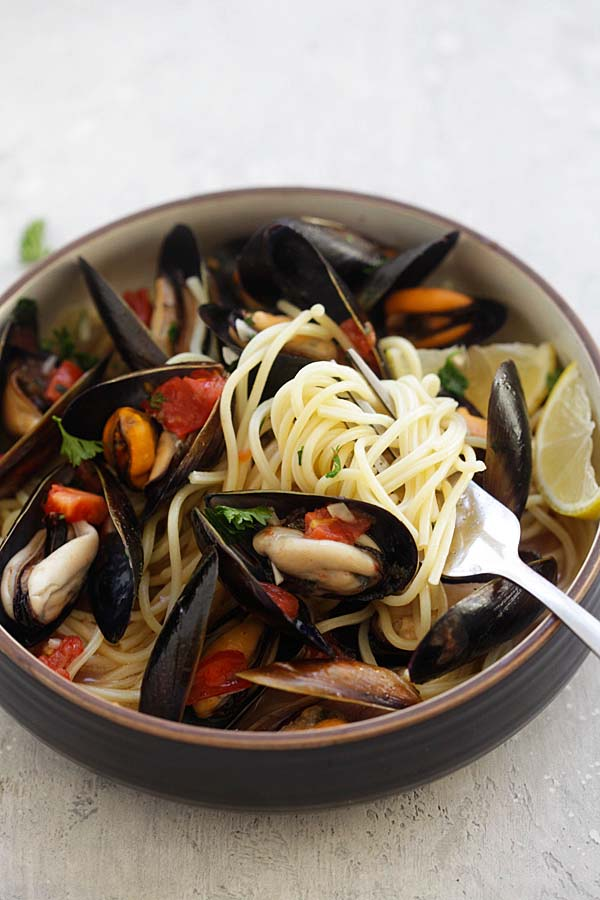 Steamed Mussels recipe with spaghetti pasta with a fork.