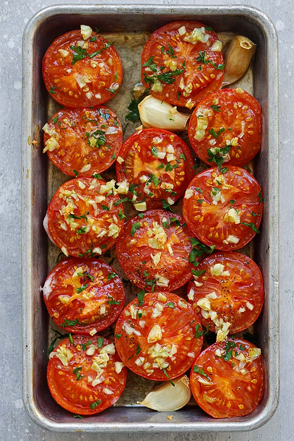Healthy, easy and quick Garlic Roasted Tomatoes in a baking tray.