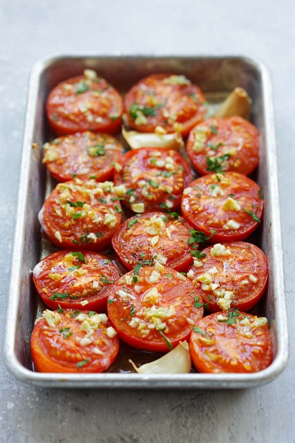 Easy and healthy roasted tomatoes topped with chopped garlic and chopped parsley.