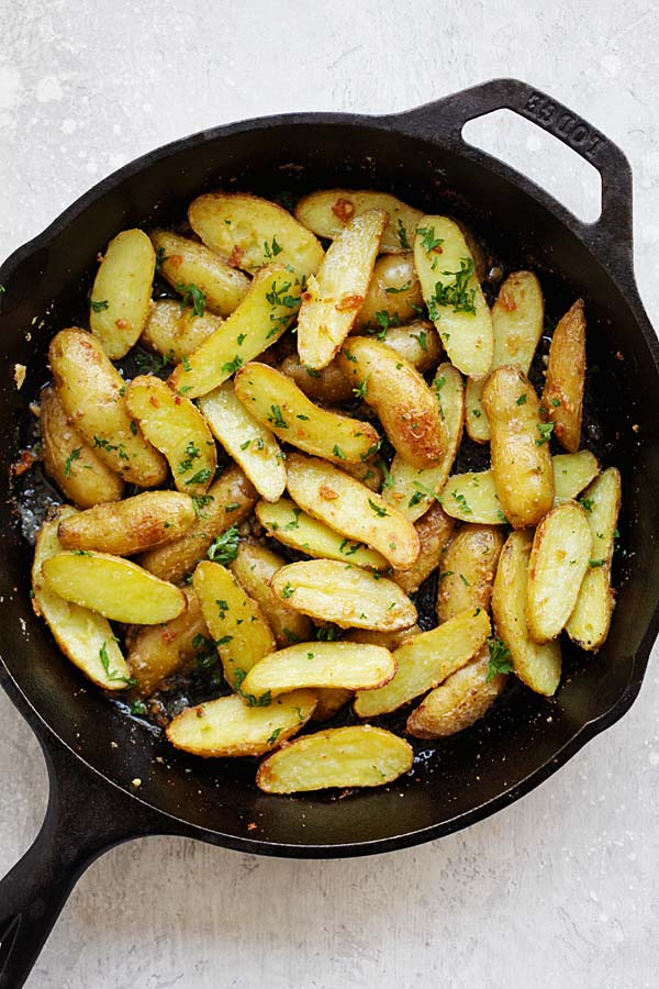 Easy and quick Garlic Butter Roasted Fingerling Potatoes in a skillet.
