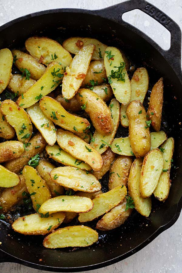 Crispy roasted fingerling potatoes in a skillet.