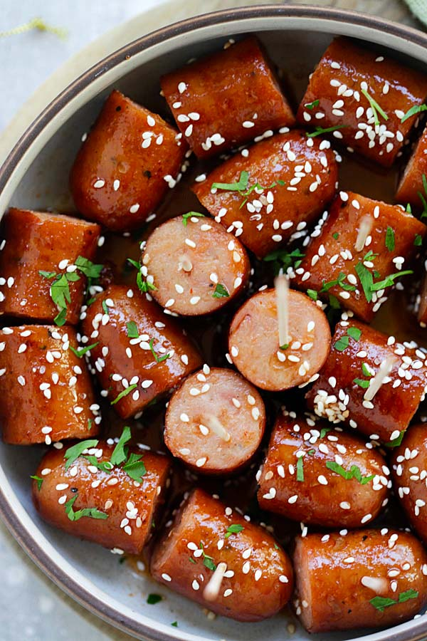 Honey Sriracha Sausage Bites - sticky, sweet and spicy sausage bites with honey sriracha sauce. An easy delicious appetizer that is a crowd pleaser | rasamalaysia.com