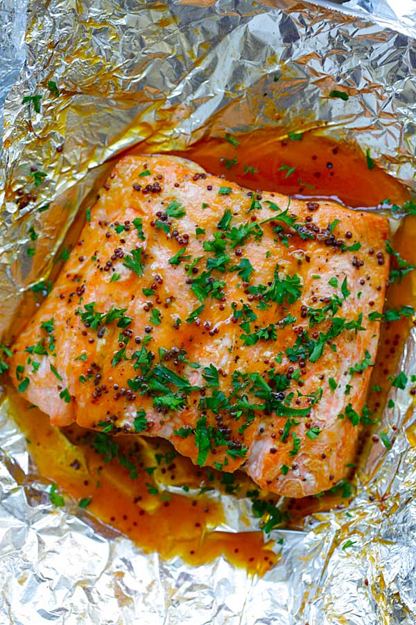 Easy and quick foil baked salmon with honey, dijon mustard and Asian chili-garlic sauce.