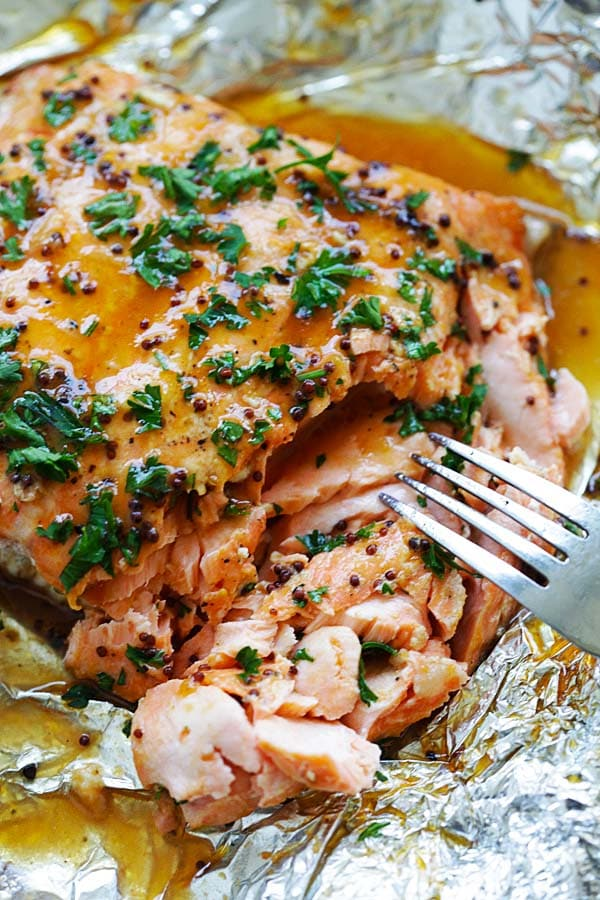 Flaky and juicy spicy honey salmon with a fork.