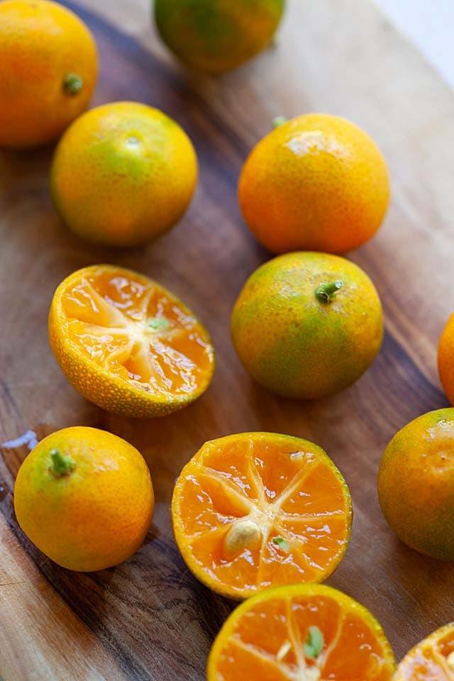 Calamansi fruit, sliced into halves.