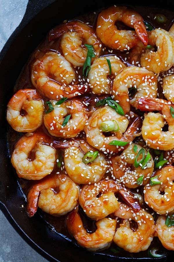 Sweet and sour shrimps garnished with sesame seeds.