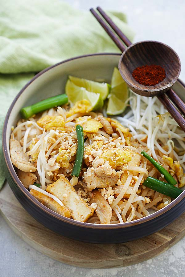 Stir-fry Thai rice noodles with chicken breast, fried tofu, Thai rice noodles (rice sticks) and Pad Thai sauce.