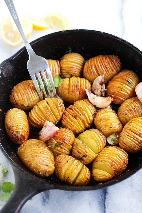 Hasselback potatoes in a cast-iron skillet