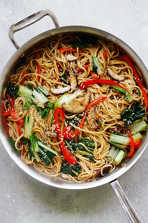 Lo Mein noodles with healthy vegetables in a bowl with a pair of Chinese chopsticks