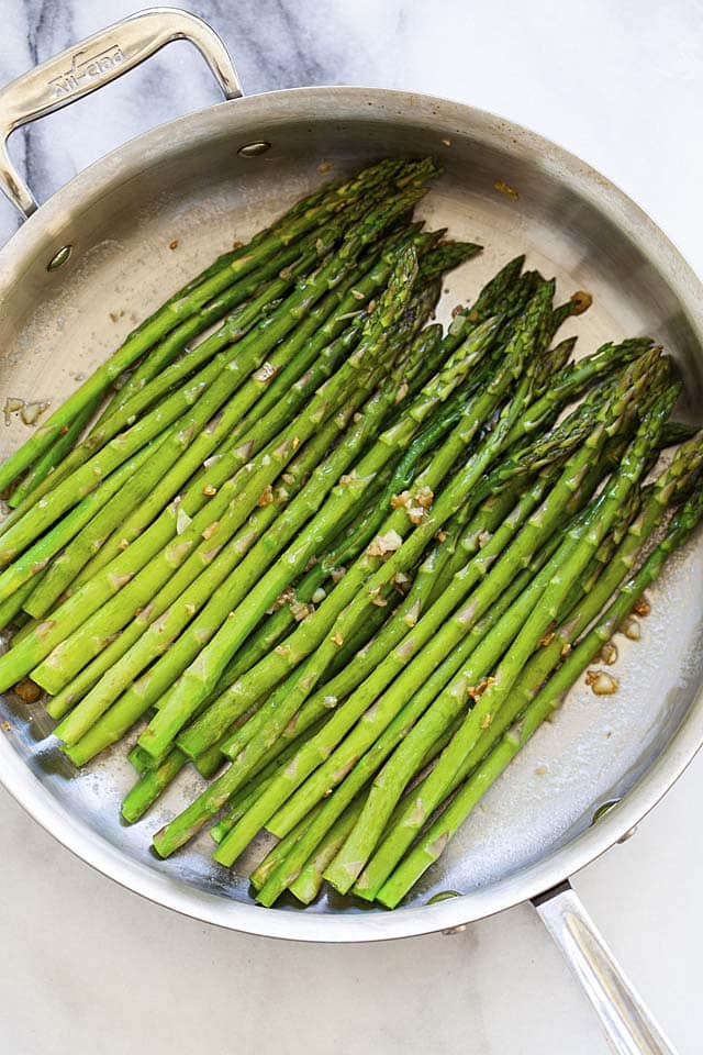 Stove top cooked asparagus with butter and garlic.