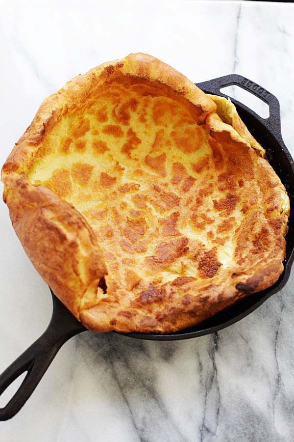 Perfect, puffy and fluffy Dutch Baby in hot cast-iron skillet