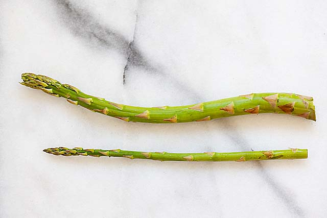 Asparagus with skinny and thick stems or stalks.
