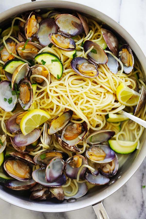 Close up of spaghetti pasta with clams, zucchinis in white wine sauce ready to serve.