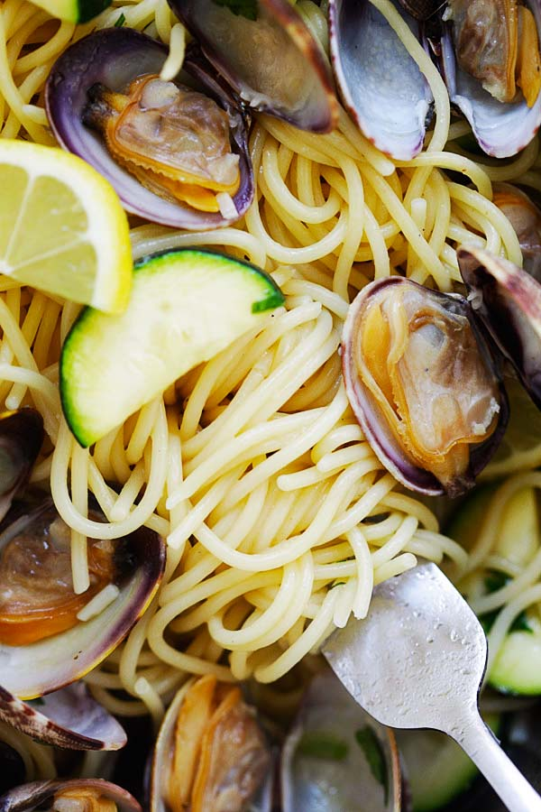 Al dente spaghetti in a fork with clams.