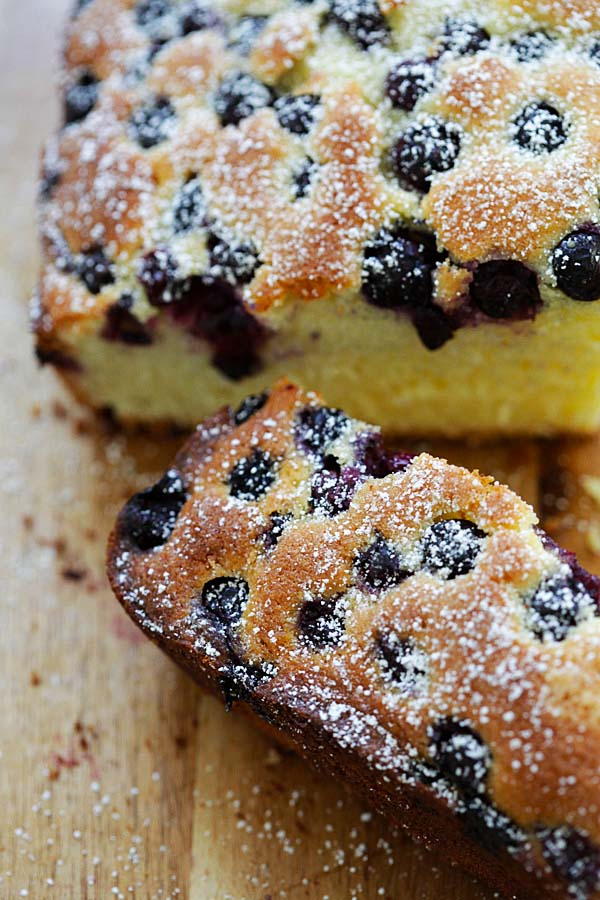Sliced blueberry butter cake dusted with powdered sugar.
