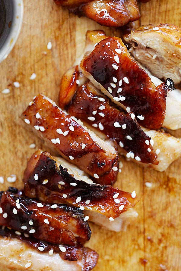 Sliced Char Siu Chicken topped with sesame seeds.