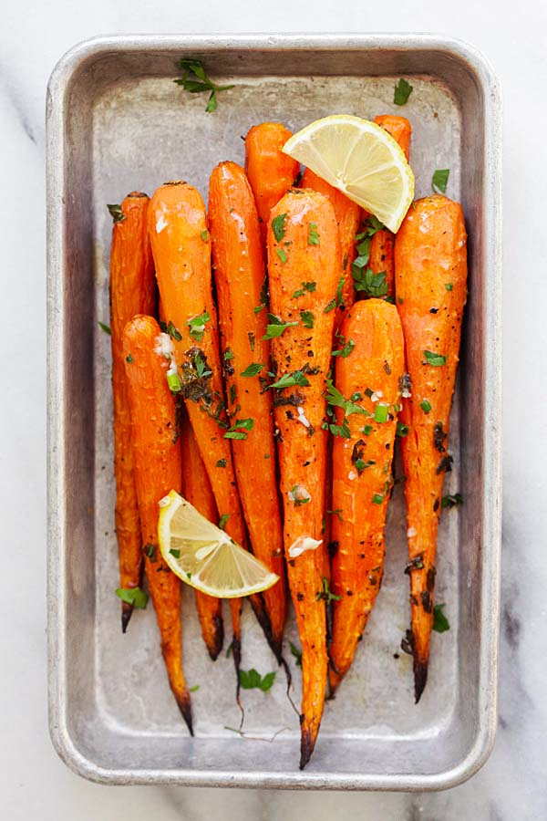 Lemon Herb roasted carrots recipe with lots of thyme, oregano, parsley and lemon juice.