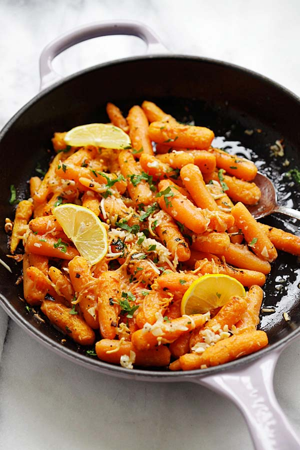 Healthy homemade Lemon Parmesan Roasted Carrots in a skillet.