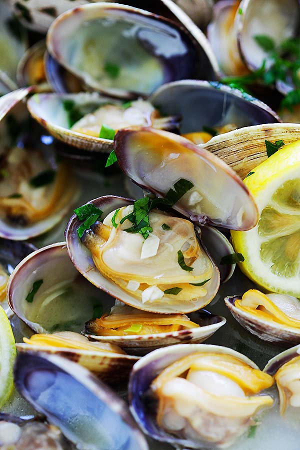 Close up of steamed clams in a beer broth
