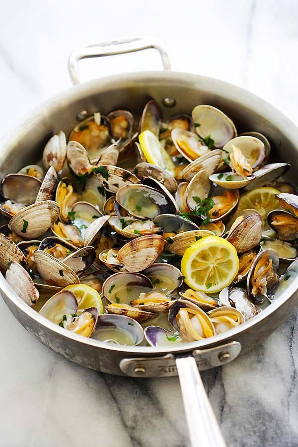 Skillet of clams steamed with beer, butter and lemon sauce.