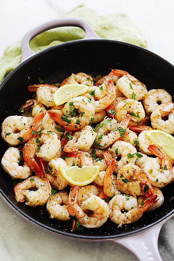 Easy and quick sauteed lemon pepper shrimp in a skillet.