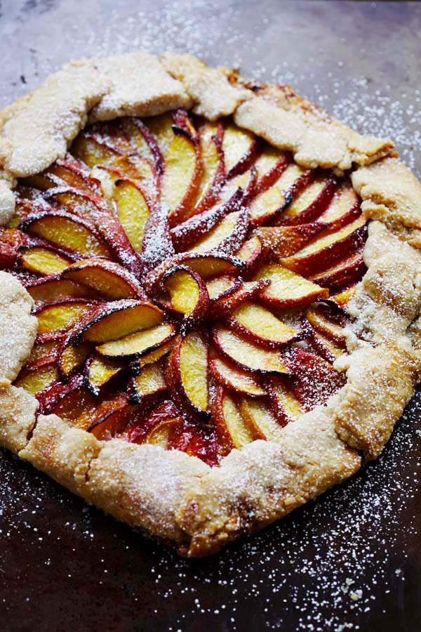 Baked peach tart with flaky pie crust.