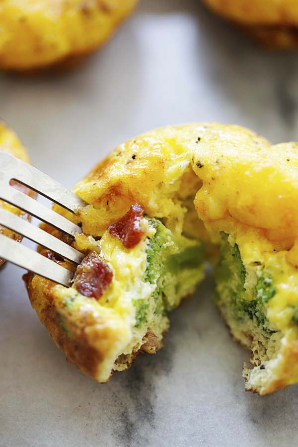 Broccoli bacon egg bites, in half, ready to serve.