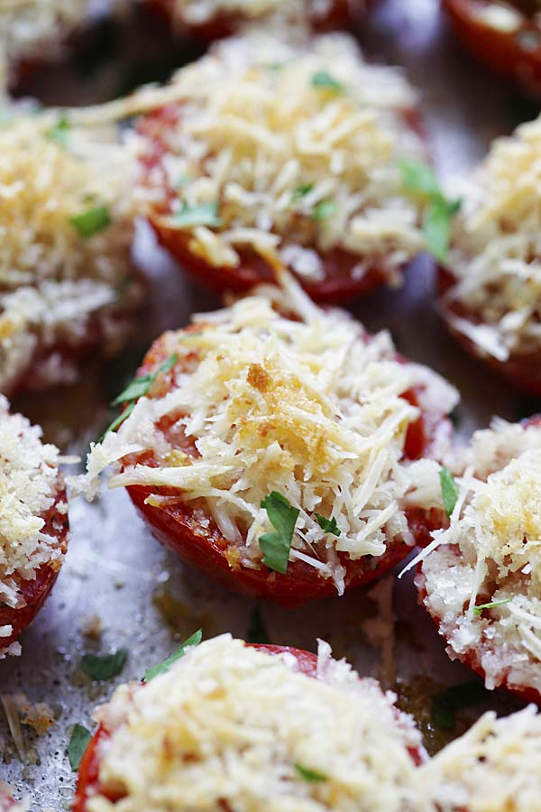 Baked tomatoes on a baking sheet.