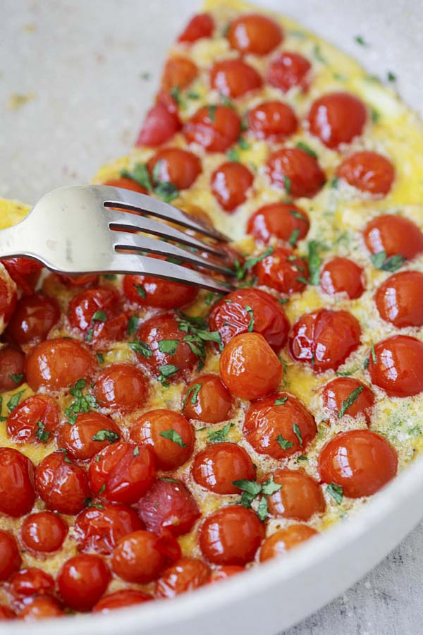 Homemade healthy Italian fritata with cherry tomatoes at the top.