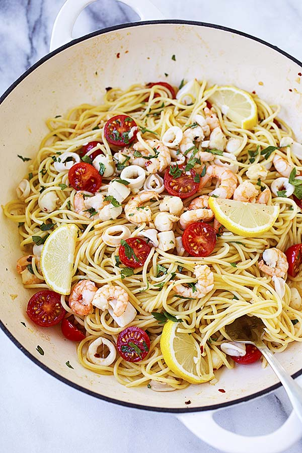 Seafood Scampi in a white skillet.