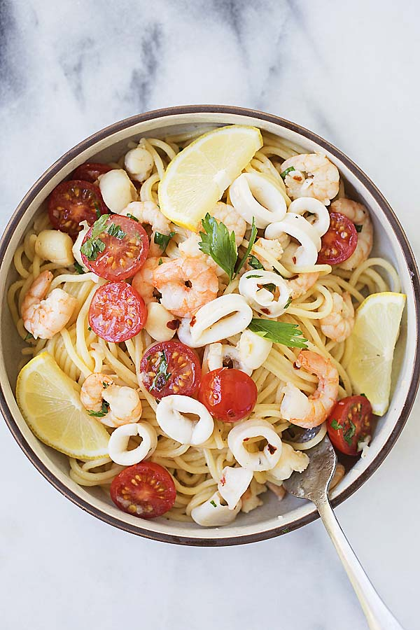 Seafood scampi spaghetti pasta with shrimp, squid and scallops, in a lemon butter sauce.