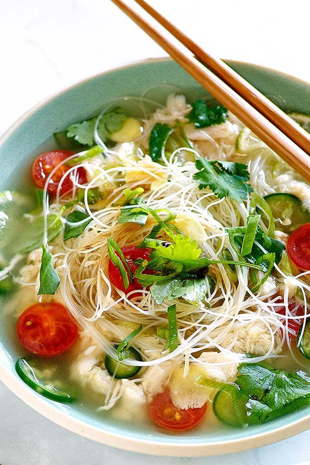 Healthy Asian Chicken Soup with chicken breast, rice noodles and herbs.