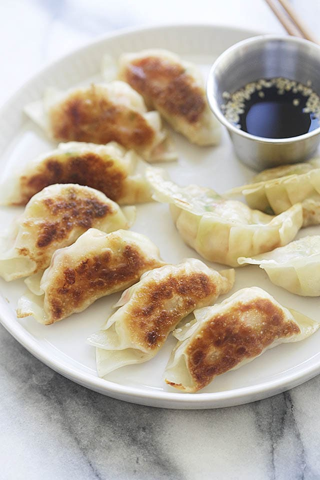 Serving potstickers with Chinese black vinegar dipping sauce.