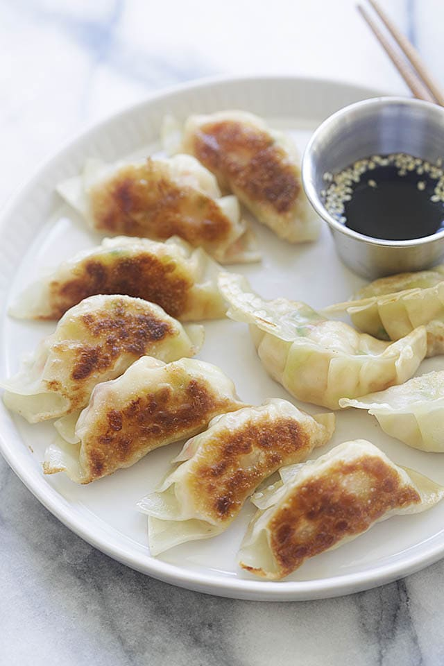 Shrimp Potstickers - delicious potstickers filled with juicy shrimp. This potstickers recipe is so easy with step-by-step picture guide. Learn how to make homemade potstickers today!
