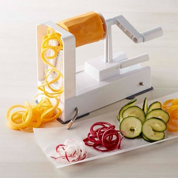 Making zucchini noodles or zoodles using a spiralizer.