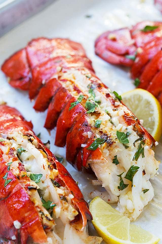 Garlic Butter Lobster Tail - crazy delicious lobster in garlic herb and lemon butter. This lobster tail recipe is so delicious you want it for dinner every day!