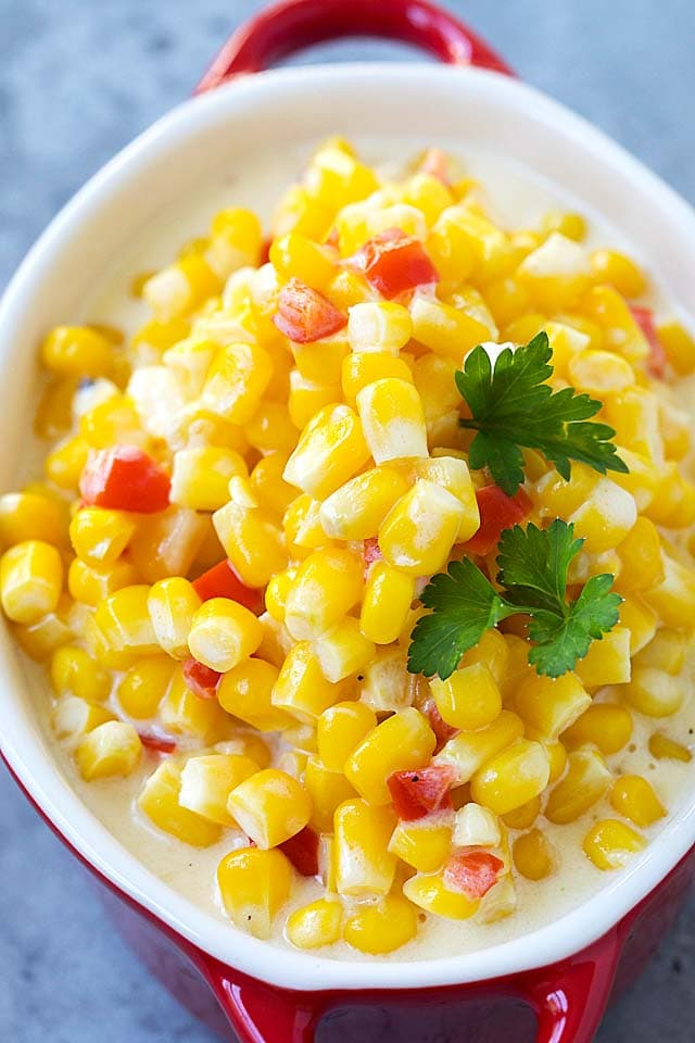 Easy and quick creamed Corn garnished with parsley, in a creamy sauce.