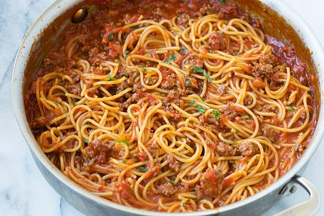 Make Spaghetti and meat sauce in a skillet on the stove top.