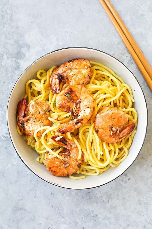 Shrimp Garlic Noodles, served in a bowl, with a pair of chopsticks.