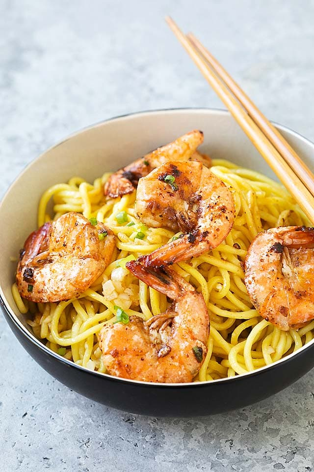 Easy and quick shrimp garlic noodles served in a bowl with chopsticks, ready to be served.