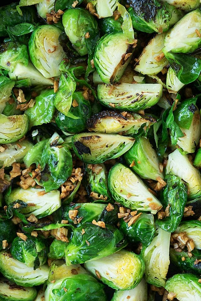 Close up shot of pan fry brussels sprouts in a cast-iron skillet.