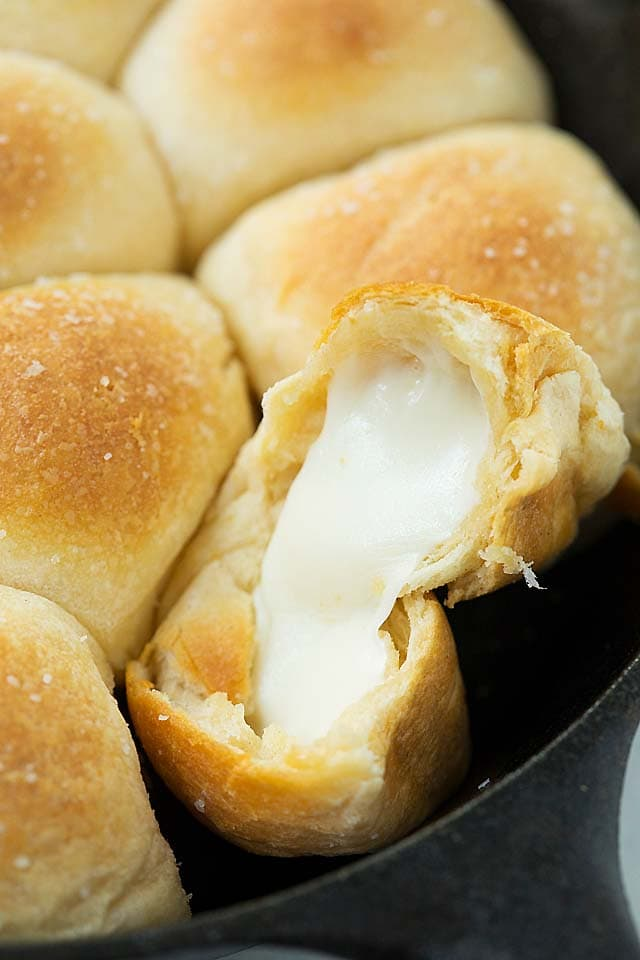 Cheese bombs with hot and melted mozzarella cheese strings oozing out.