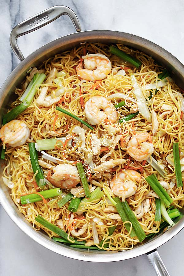 Chow mein (chowmin) in a skillet made of chow mein ingredients of egg noodles, chicken and vegetables.